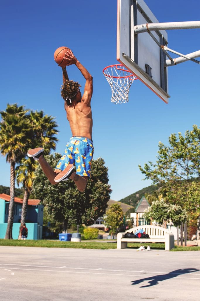 Boyr dunking the ball